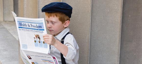 Boy reading manifesto